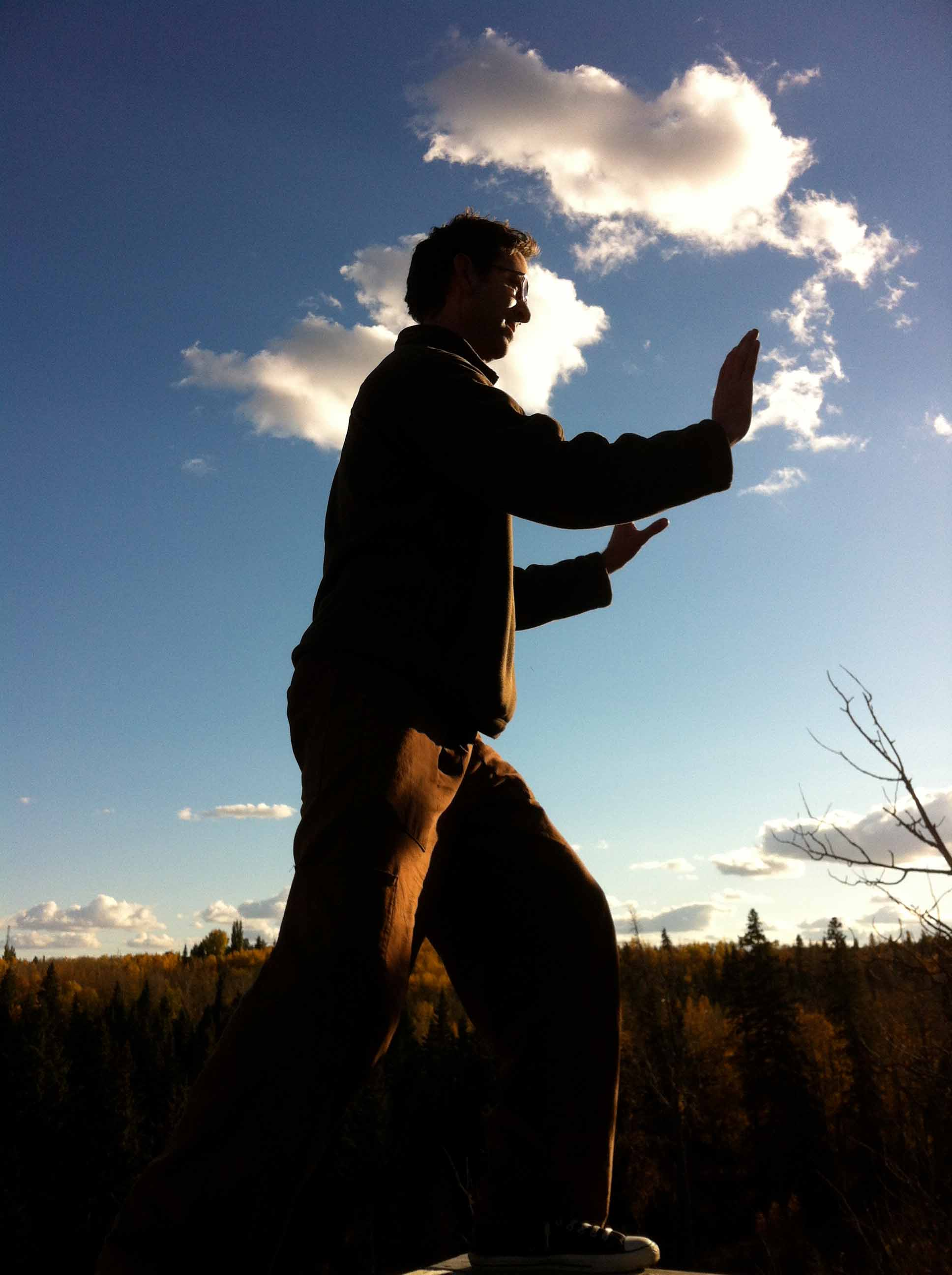 Paul Bromley practicing tai chi in the Edmonton river valley